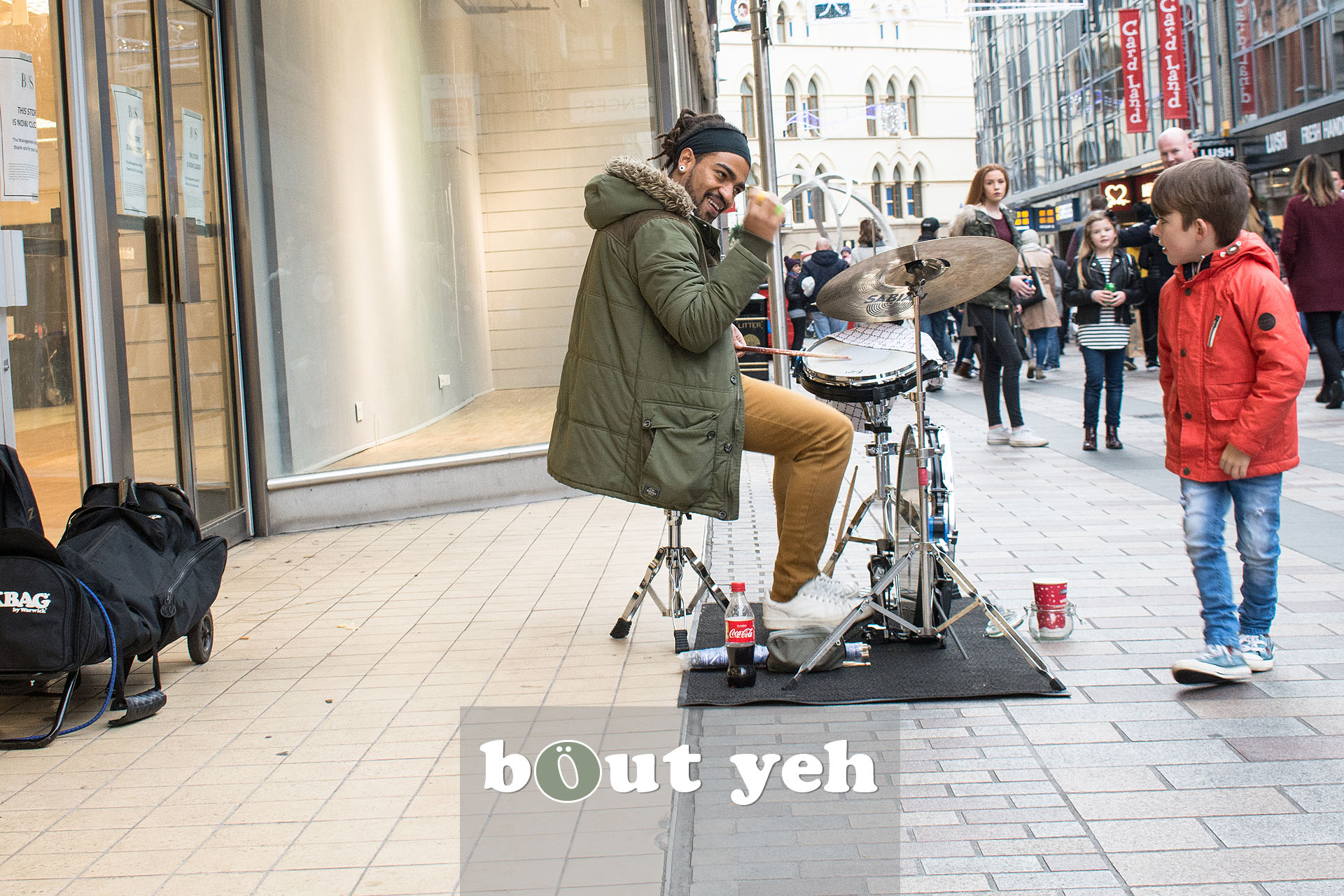 Busker from Brazil drumming in Belfast city centre. Photo 3231.