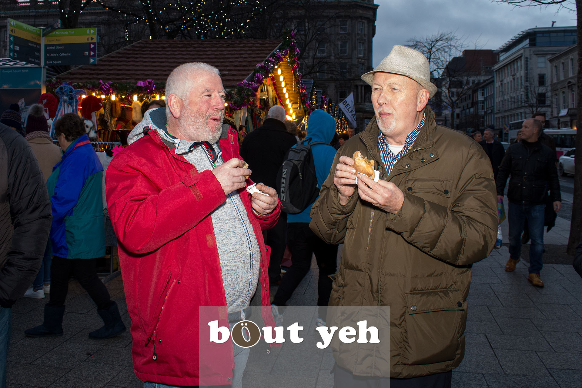 Middle aged men eating burgers in Belfast city centre. Photo 3265.