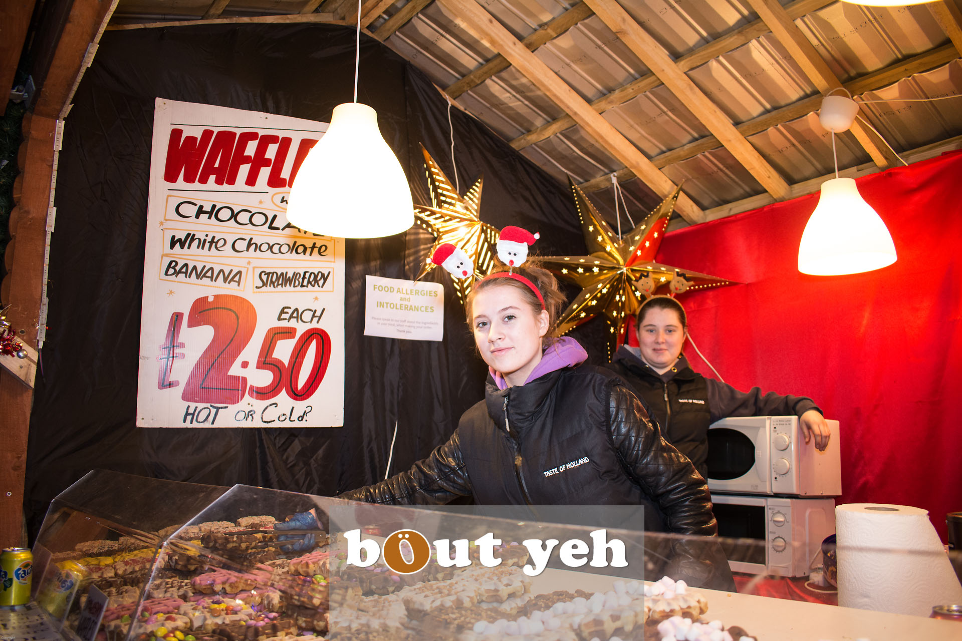 Two women at Belgian waffle stand, Belfast Continental Christmas Market, City Hall, Belfast, Northern Ireland - bout yeh photographers Belfast photo 3290.