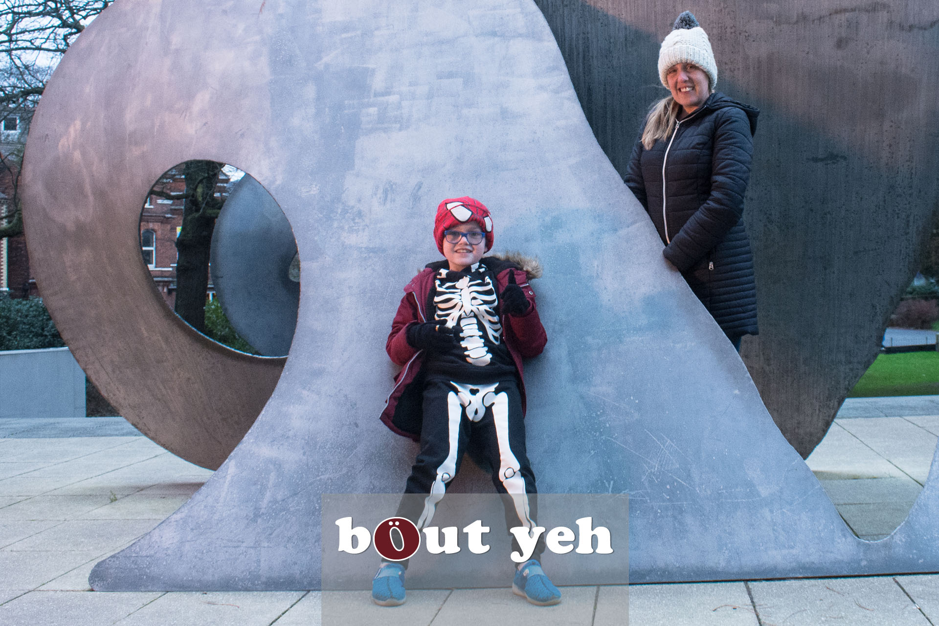 Mother and son photographed with art installation in front of Ulster Museum, Belfast - photo 4360.